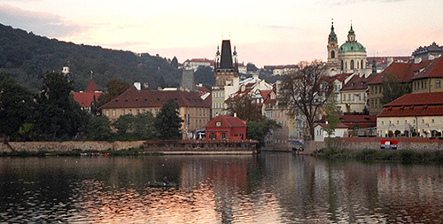The Vlatava river in Prague.  Note the early morning fisherman. (2003)