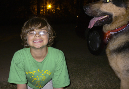 Alex and Argus at The Greenway at night.  Streetlight in distance.  (2007)