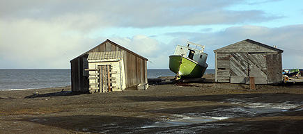 Boat between houses in Barrow, east of the whalebone arch.  (2007)