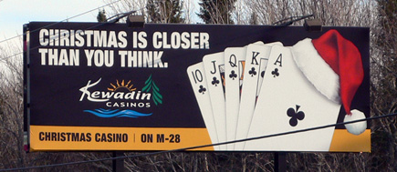 Billboard for the casino in Christmas, Michigan.  Don't mind the telephone wires please.  (2007)
