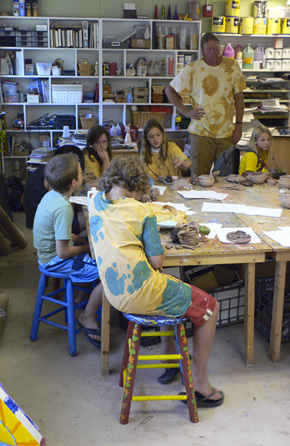 Alex working with his class at pottery camp.  (2008)