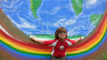 Nephew Alex plays Titan with a mural on Gaines Street.  (2008)