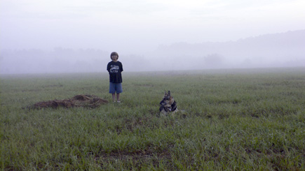 Alex and Sheriff at The Lake Bottom surrounded by the early Sunday morning fog.  (2008)