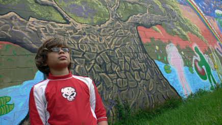 Nephew Alex in front of another Gaines Street mural.  (2008)
