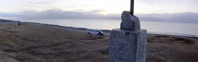 Multiple photos stitched together to create a panoramic mosaic of the Wiley Post monument about ten miles west of Barrow, Alaska.  (2007)